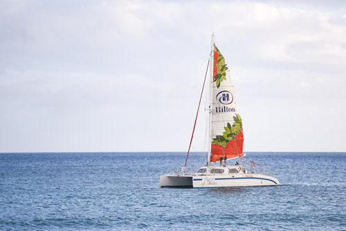 Explore The Waikiki Coastline Aboard New Spirit Of Aloha A 65 Foot Sailing Catamaran Custom Built For Hilton Hawaiian Village Beach Resort